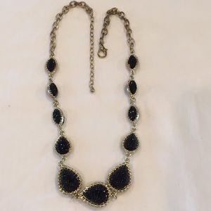 Necklace- sparkles of black shaped beads in gold